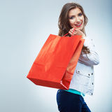 Portrait of happy smiling woman hold shopping bag. Female mode. L isolated studio background Stock Photos