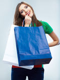 Portrait of happy smiling woman hold shopping bag. Female mode. L isolated studio background Royalty Free Stock Images