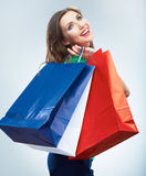 Portrait of happy smiling woman hold shopping bag. Female mode. L isolated studio background Stock Photography