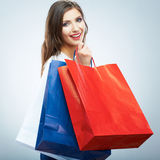 Portrait of happy smiling woman hold shopping bag. Female mode Stock Image