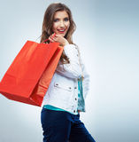 Portrait of happy smiling woman hold shopping bag. Female mode. L isolated studio background Royalty Free Stock Photography