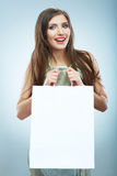 Portrait of happy smiling woman hold shopping bag. Royalty Free Stock Photography