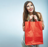 Portrait of happy smiling woman hold shopping bag. Stock Image