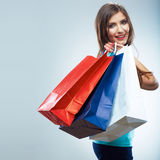Portrait of happy smiling woman hold shopping bag. Stock Images