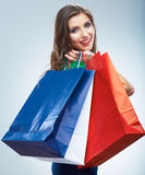 Portrait of happy smiling woman hold shopping bag. Female model  studio background Royalty Free Stock Photo