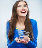 Portrait of happy smiling woman hold shopping cart. Female mod Stock Image