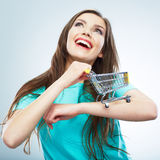 Portrait of happy smiling woman hold shopping cart. Female mod Stock Photo