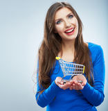 Portrait of happy smiling woman hold shopping cart. Female mod Royalty Free Stock Photography