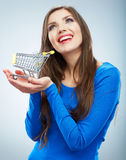 Portrait of happy smiling woman hold shopping cart. Female mod Stock Photography