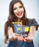 Portrait of happy smiling woman hold shopping cart. Female mod Stock Photos