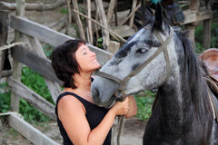 Portrait happy smiling woman with horse. Portrait happy smiling woman with grey horse Royalty Free Stock Photography