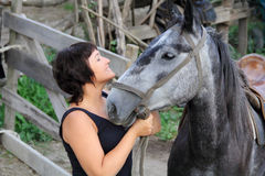 Portrait happy smiling woman with horse. Portrait happy smiling woman with grey horse Stock Images