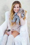 Portrait of happy smiling woman posing with her cute rabbit toy Royalty Free Stock Photography