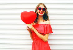 portrait happy smiling woman red dress sunglasses air balloons heart shape over white background 85222126