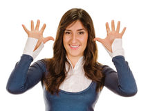Portrait of happy smiling woman showing ten fingers Stock Photography
