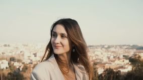 Portrait of happy smiling woman standing against the panorama of Rome, Italy. Female looking at camera, enjoying the day. Portrait of happy smiling woman royalty free stock images