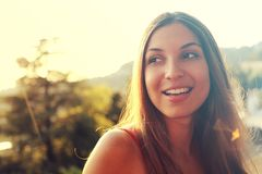 Portrait of happy smiling woman standing on sunny summer or spring day outside. Cute smiling woman looking to the side filtered i stock photo
