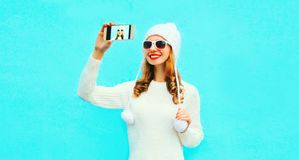 Portrait happy smiling woman taking selfie picture by smartphone royalty free stock photography