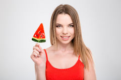 Portrait of happy smiling woman with  watermelon shaped lollipop Royalty Free Stock Photo
