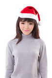 Portrait of happy, smiling woman wearing X'mas santa hat Royalty Free Stock Image