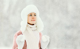 Portrait happy smiling woman wearing a sweater and hat over winter Royalty Free Stock Photos