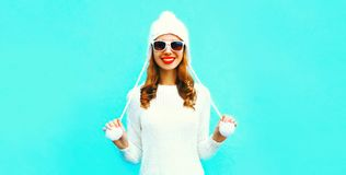 Portrait happy smiling woman in white knitted sweater and hat stock images
