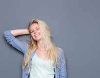 Portrait of a happy smiling young blond woman Stock Photography