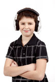 Portrait of a happy smiling young boy listening to music on headphones Stock Photography