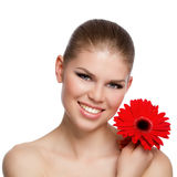 Portrait of happy smiling young Caucasian woman holding a red flower Stock Image