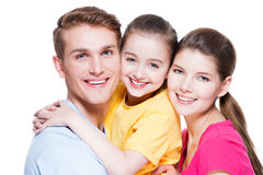 Portrait of happy smiling young family with kid. Stock Photography