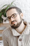 Portrait of happy smiling young kind look spectacled man with beard. Portrait, happy smiling man, indoor portrait, spectacled Stock Images