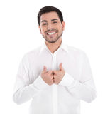 Portrait of happy smiling young man in white shirt isolated. Stock Photo