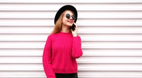 Portrait happy smiling young woman calling on smartphone on city white wall. Background royalty free stock images