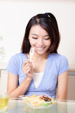 Portrait of happy smiling young woman eat salad Royalty Free Stock Images