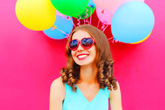 Portrait happy smiling young woman having fun over an air colorful balloons pink. Background royalty free stock photos