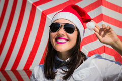Portrait of a happy smiling young woman in Santa Claus hat Stock Image