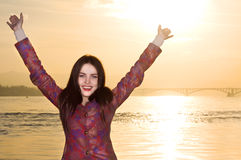 Portrait of happy smilling woman hands up Stock Photos