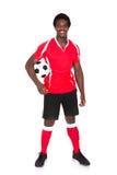 Portrait of happy soccer player Stock Photo