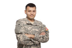 Hispanic soldier portrait. Portrait of a happy soldier with arms crossed stock images