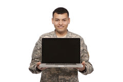 Hispanic Soldier showing laptop Royalty Free Stock Image