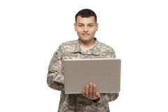 Soldier working on laptop computer Royalty Free Stock Photo