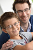 Portrait of happy son with his father. Young boy and daddy wearing eyeglasses Stock Images