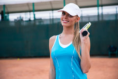 Portrait of a happy sports woman playing tennis Stock Images