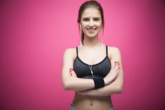 Portrait of a happy sports woman standing with arms folded Royalty Free Stock Image