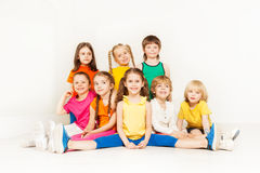 Portrait of happy sporty kids posing together. Portrait of happy sporty boys and girls posing together against blanked background Stock Images