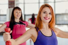 Training with mom in gym stock photography