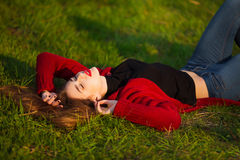 Portrait of happy sporty woman relaxing in park. Joyful female model breathing fresh air outdoors. Healthy active Stock Photo