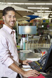 Portrait of a happy store clerk in shop Stock Photography