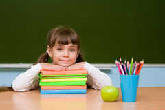Portrait of a happy student of elementary school near chalkboard Royalty Free Stock Photography