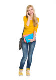 Portrait of happy student girl speaking mobile Royalty Free Stock Photography
